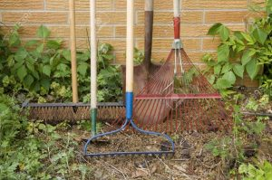 3040475-a-still-life-of-various-tools-used-in-the-yard-and-garden-against-a-brick-wall-stock-photo